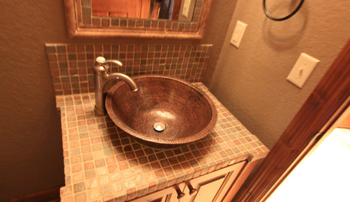 Avoid moving plumbing when bathroom remodeling.